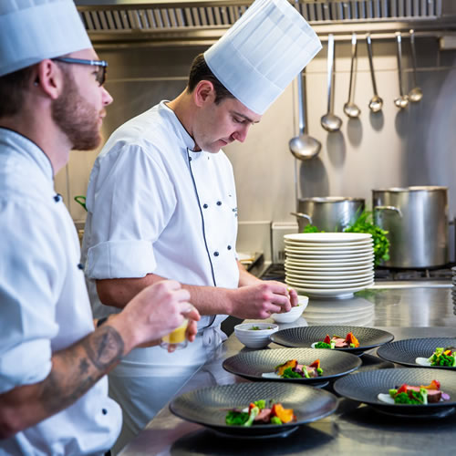 Food Preparation: Mat Lee, Damien McDermid and David Pugh in BCEC kitchen preparing gourmet food