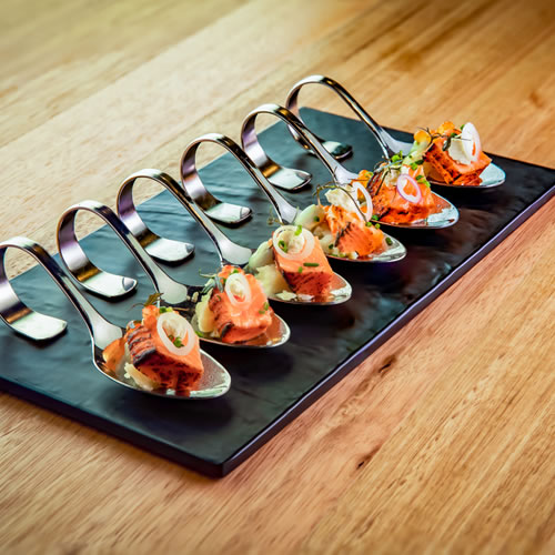 Food: Gourmet canapes on silver spoons