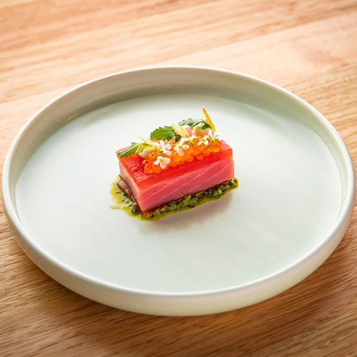 Food: Fresh salmon, pesto and caviar on white plate