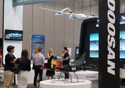 World of Drones exhibition stand with drone in situe and people